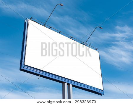 Billboard on the background of a beautiful blue cloudy sky. Mock up for your advertising or announcements stock photo