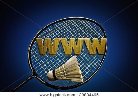 Gold WWW letters on badminton racket with one shuttlecock. stock photo