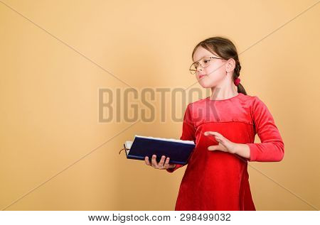 Adorable Girl Love Books. Kid Girl With Book Or Notepad. Back To School Concept. Reading Book As Hob