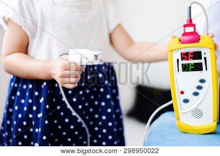 Fingertip Pulse Oximeter on finger of little baby child in hospital stock photo
