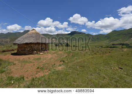Home in the hilly landscape of the Butha-Buthe region of Lesotho. stock photo