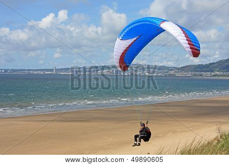 paraglider flying over Aberavon beach in Wales stock photo