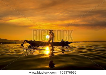 Fishermen in Inle lakes sunset Myanmar. Fishermen is finish a day of fishing in Inle lake Myanmar (Burma). Inle is one of the most favorite tourist places in Myanmar (Burma) stock photo