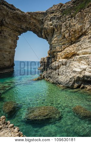 Image of unique and scenic arch in the cliffs Paxi Greece stock photo