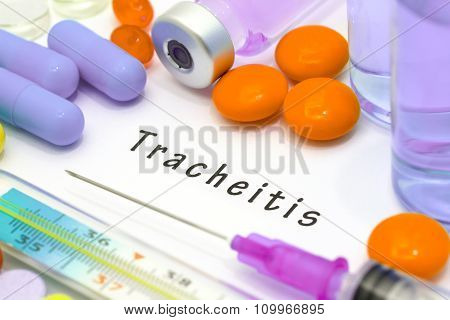 Tracheitis - diagnosis written on a white piece of paper. Syringe and vaccine with drugs. stock photo