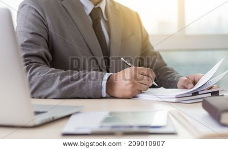 Businessman working reading documents graph financial to job succes Analyze document plans stock photo