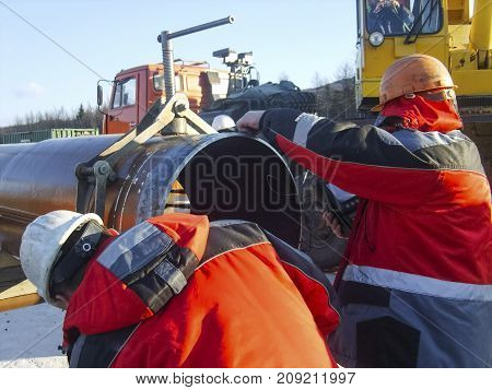 Safety at work. Welding and grinding of iron constructions. Industrial weekdays welders and fitters. stock photo