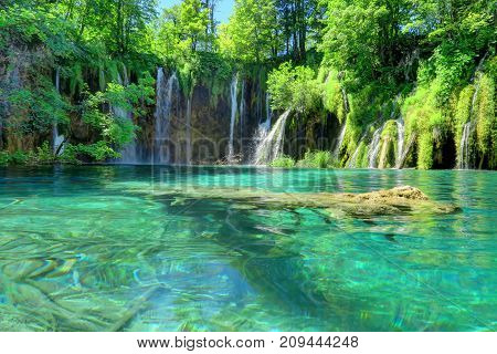 Croatia's Plitvice Lakes National Park is famous for the sapphire color of its water in 16 lakes stock photo