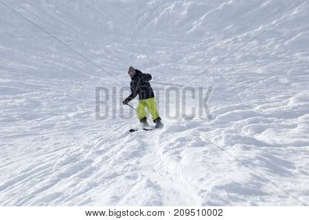 Athlete skiing in the snowy mountains . In the park in nature stock photo