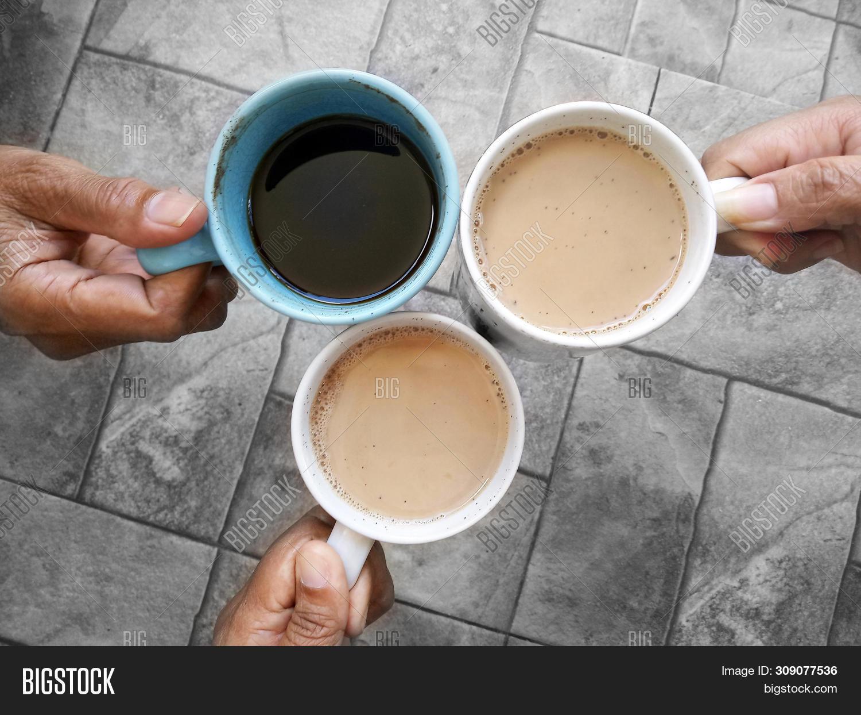 Cheers Coffee. Three Cups Of Coffee Hold By Hands. 3 Best Friends Making Cheers Coffee. Coffee Break