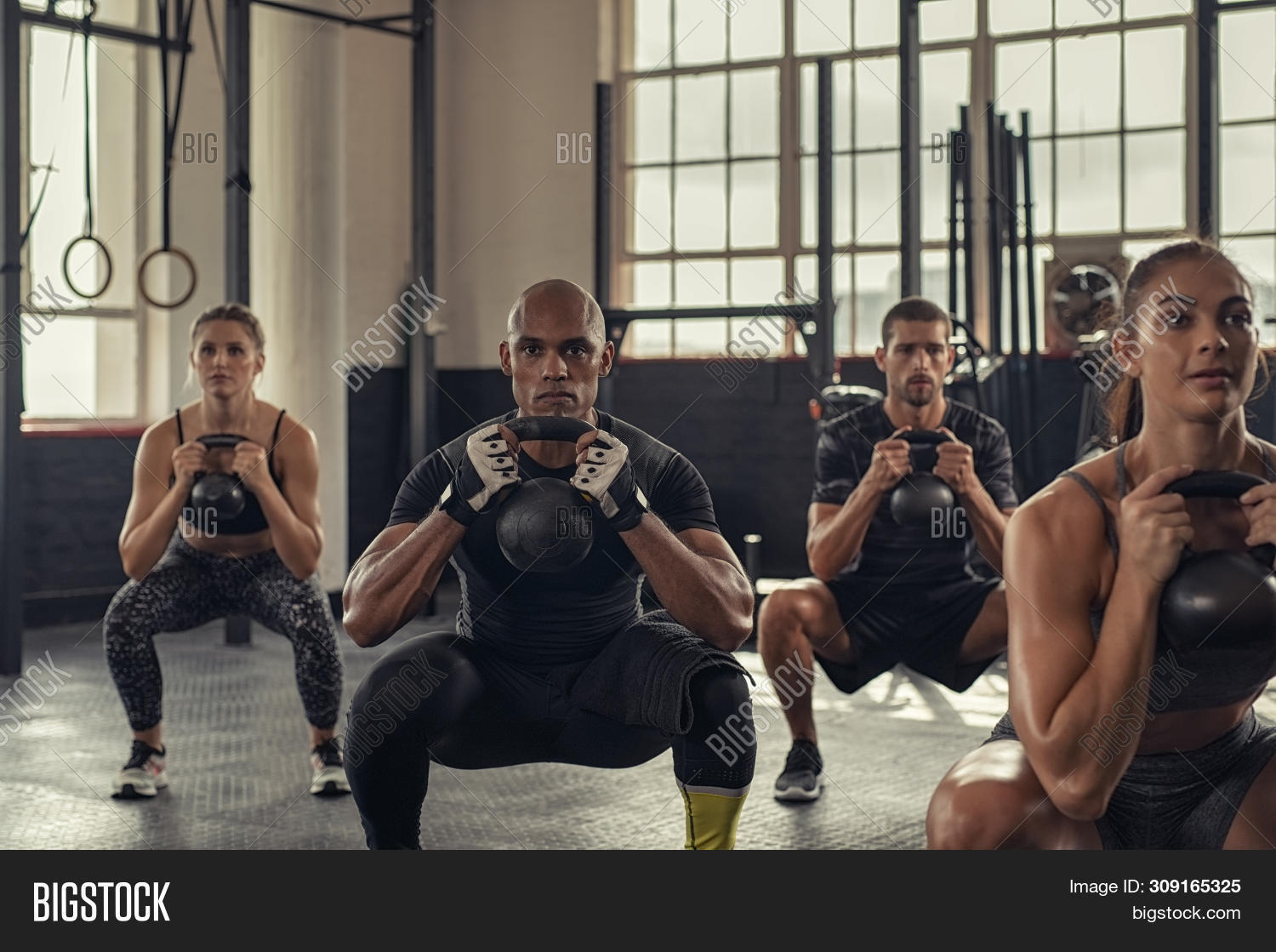 african,american,athletic,bell,class,concentration,cross,determination,determined man,determined woman,endurance,exercise,fit,fitness,group,grunge,gym,healthy,heavy lifting,heavy weight,heavy weight lifting,holding,industrial,kettle,kettle bell,kettlebell,lifting,man,multi ethnic group,multiethnic,muscular,people,power,sport,squat,squat exercise,squats,squatting,strength,strength training,strong,team,training,weight,weight lifting,weightlifting,woman,workout,young