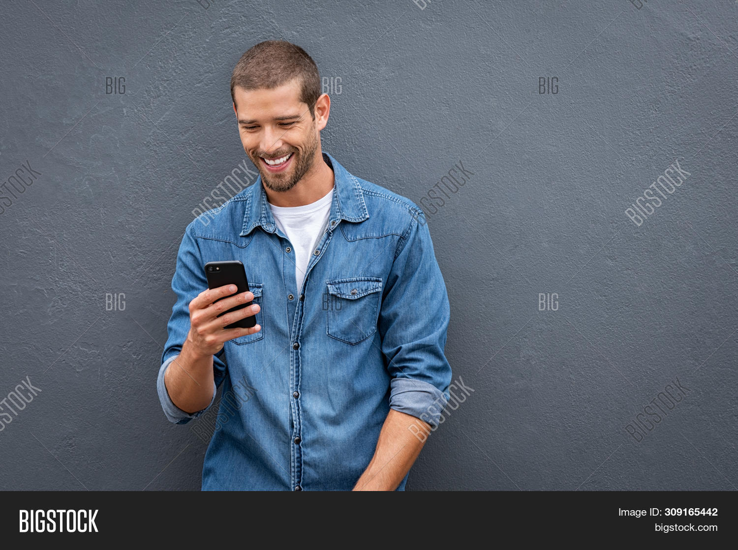 app,application,background,carefree,casual,cellphone,chatting,cheerful,communication,connection,cool,copy space,gray background,grey,grey background,grey wall,guy,happy,holding,internet,isolated,joyful,man,message,message phone,messaging,mobile,mobile icon,people,phone,phone message,satisfaction,smart,smartphone,smile,sms,stylish,technology,telephone,texting,toothy smile,trendy,typing,using,using phone,wall,wifi,young,young man