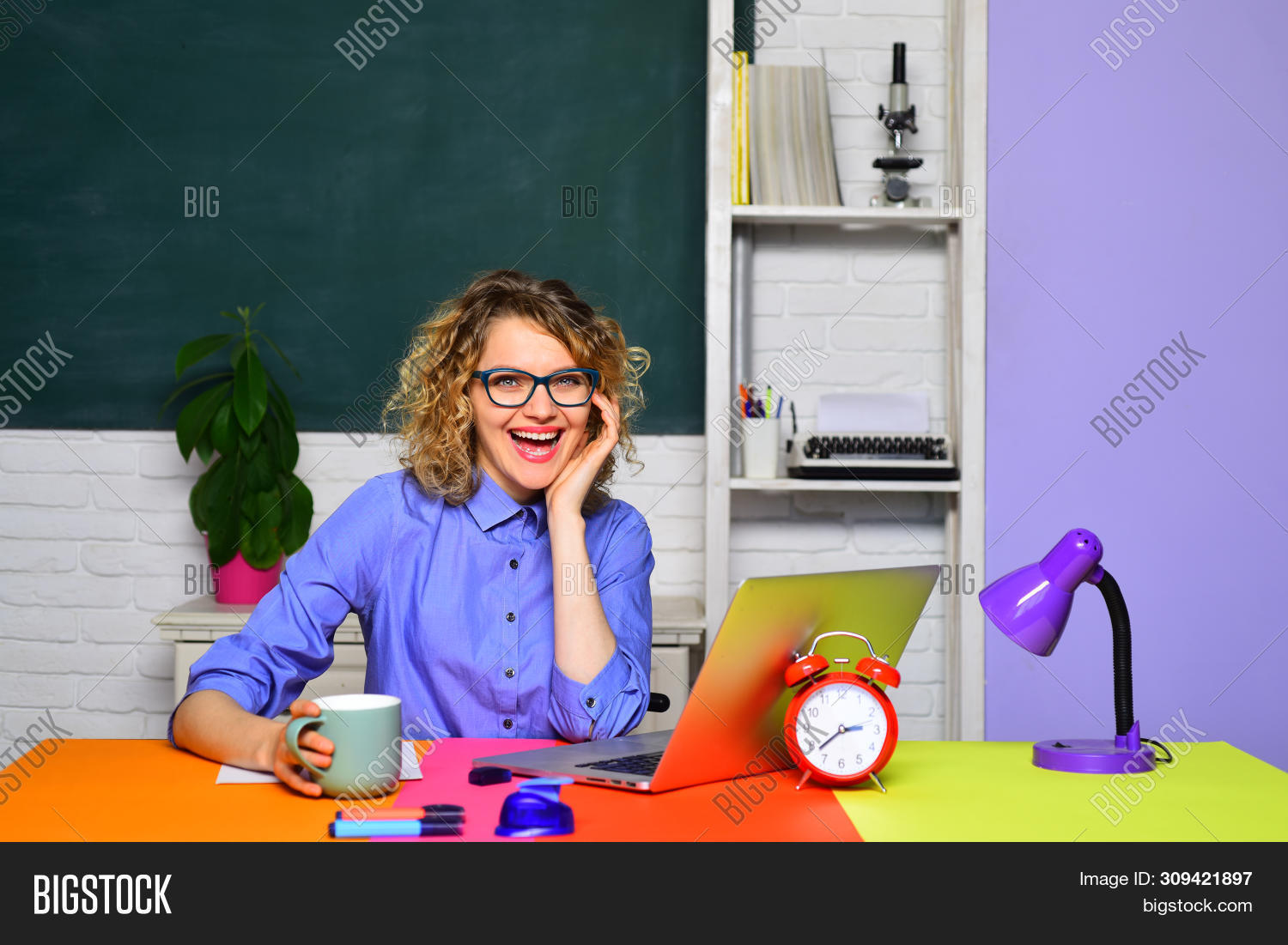 Adorable Teacher In Classroom. Young Happy Teacher. School Student. Creative Young Female Student In