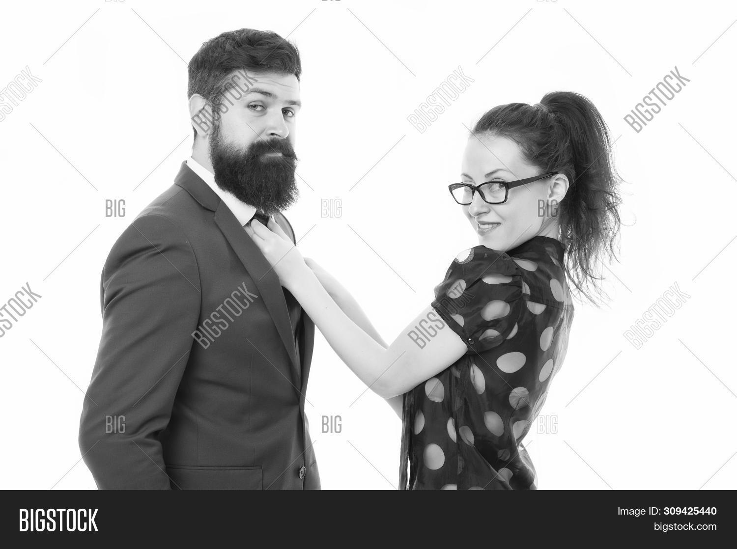 Help each other look perfect. Business partners man and woman adjust outfit before business conference or meeting. Boss and attractive lady assistant white background. Last detail. Business relations.