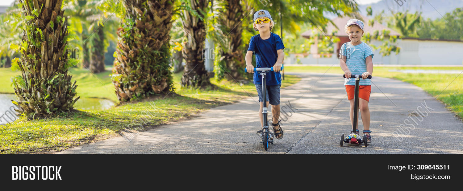 BANNER,active,activity,balance,blond,board,boy,brother,caucasian,child,childhood,children,city,curly,cute,exercise,family,forest,fun,girl,happy,healthy,helmet,joy,kick,kid,learn,leisure,lifestyle,little,motion,outdoor,outside,park,play,preschool,rainbow,residential,ride,roller,safe,scooter,sport,spring,street,summer,toddler,transport,urban,young