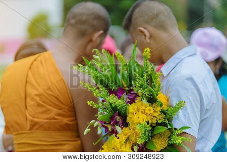 Teachers And Students Together Make Merit To Give Food Offerings To A Buddhist Monk On Important Rel