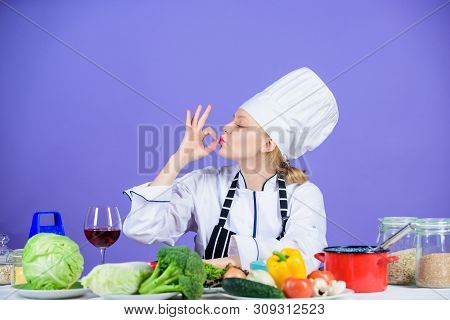 Amazing taste. Turn ingredients into delicious meal. Culinary skills. Woman chef wear hat apron near table ingredients. Girl adorable chef teach culinary. Best culinary recipes to try at home stock photo