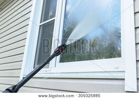 Cleaning Service Washing Building Facade And Window With Pressure Water. Cleaning Dirty Wall With Hi