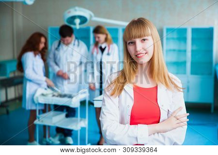 Portrait of a doctor intern. Medical students profession staff. multinational people - doctor, nurse and surgeon. A group of graduates of a medical university in a surgical room. stock photo