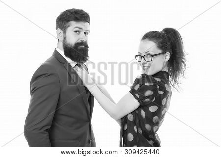 Help each other look perfect. Business partners man and woman adjust outfit before business conference or meeting. Boss and attractive lady assistant white background. Last detail. Business relations. stock photo