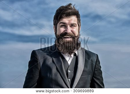 Businessman against the sky. Bearded man. brutal caucasian hipster with moustache. Future success. Agile business. Confident businessman. startup business. formal fashion. Mature hipster with beard stock photo