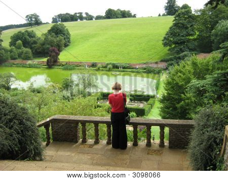Woman standing alone. Visitor looking at landscape. Holiday. Sunday. stock photo