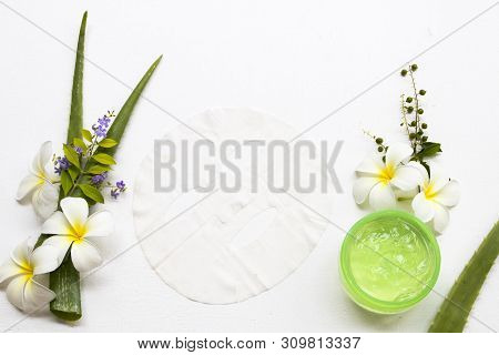 natural cosmetics soothing gel ,sheet mask aroma essence face mask extract herbal aloe vera health care for skin face of lifestyle woman arrangement flat lay style stock photo