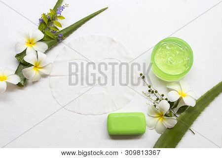 natural cosmetics soothing gel ,sheet mask aroma essence face mask and soap extract herbal aloe vera  health care for skin face of lifestyle woman arrangement flat lay style stock photo