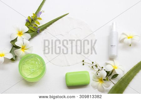 natural cosmetics soothing gel ,sheet mask aroma essence face mask and soap extract herbal aloe vera with collagen water spray health care for skin face of lifestyle woman arrangement flat lay style stock photo