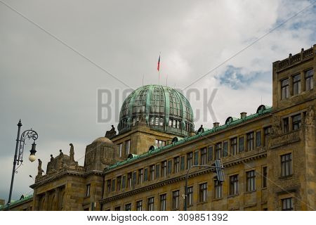 Prague, Czech Republic: Dome of the Ministry of Industry and Trade of the Czech Republic Building with Czech Flag and Sculptures stock photo
