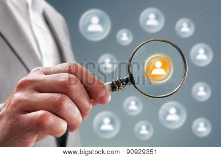 Businessman with magnifying glass on team personnel or contact icon concept for recruitment, social media, network, community and  internet marketing stock photo