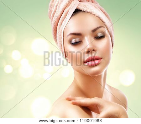 Spa Woman. Beautiful Girl After Bath Touching Her Face. Perfect Skin. Skincare. Young Skin, youth. Beauty female with a towel on her head pampering skin stock photo