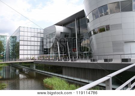 Dresden Germany - May 19 2014: Volkswagen's Glass Factory. The transparent factory is an automobile production plant in Dresden designed by architect Gunter Henn and opened in 2002. stock photo