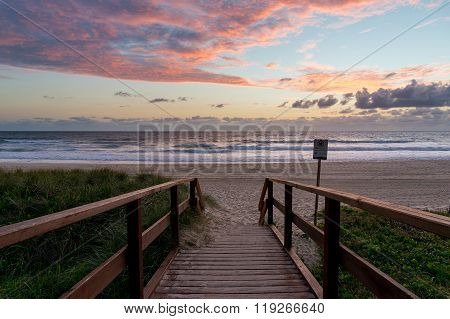 Beautiful ocean beach entrance at sunrise