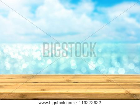 The Empty wood table top for product disply with blur blue ocean and sea view bokeh light stock photo