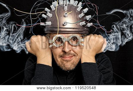 Crazy inventor with helmet for brain research stock photo