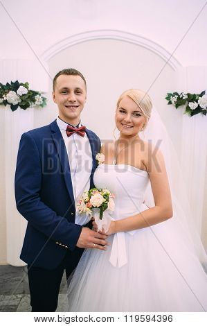Bride and groom on marriage registration. The groom looks at the bride. Newlyweds at the wedding ceremony. ** Note: Visible grain at 100%, best at smaller sizes stock photo