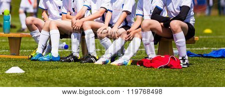 Soccer Team; Reserve Players On A Bench; Boys With Football Coach