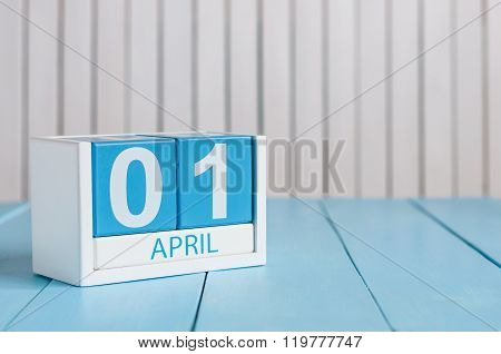 April 1st. Image of april 1 wooden color calendar on white background.  Spring day, empty space for text. All Fool's Day. stock photo