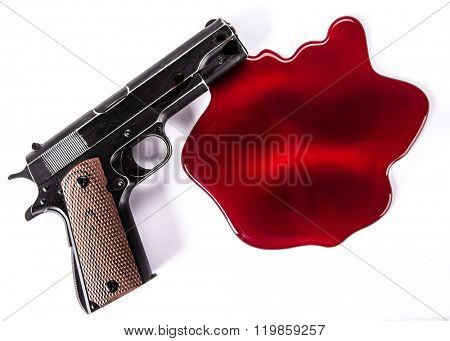 Murder concept - gun with blood on white background, close-up. stock photo