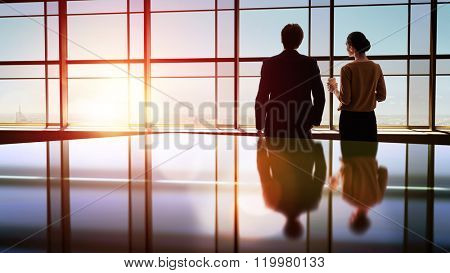 team of successful business people. two businessmen resting and talking in the office. man and woman