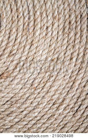 Handmade Table Mat of Jute Rope Twisted in a Spiral Form, as background stock photo