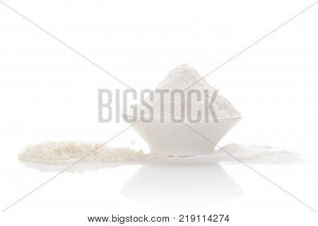 White rice with rice flour in bowl isolated on white background. Gluten free flour. stock photo