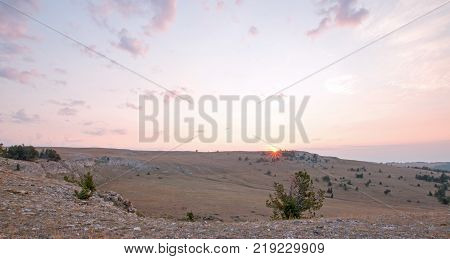Sunrise soft colors over Teacup Canyon / Bowl on Sykes Ridge in the Pryor Mountains on the Wyoming Montana state line - United States stock photo