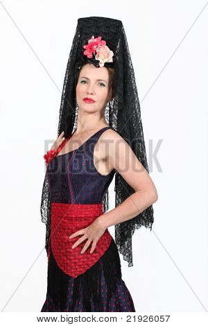 Woman in a traditional Spanish outfit with tall headdress stock photo