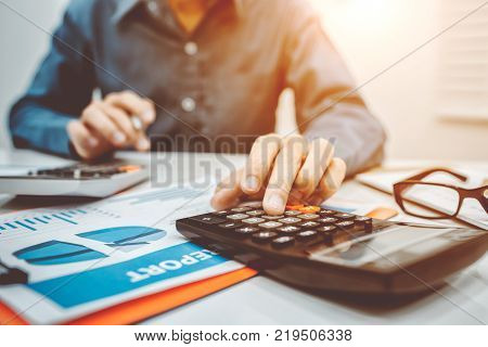 Business Man Accountant Using Calculator To Calculating Bugget