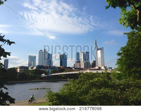 The skyline at financial district in the city of Frankfurt am Main Germany with people at recreational activities stock photo
