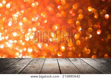 empty wooden on red lighting backdrop. christmas light background. Wood table top. can used for display or montage your products stock photo
