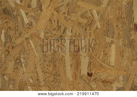 Texture of OSB with the individual strips lying unevenly across each other stock photo