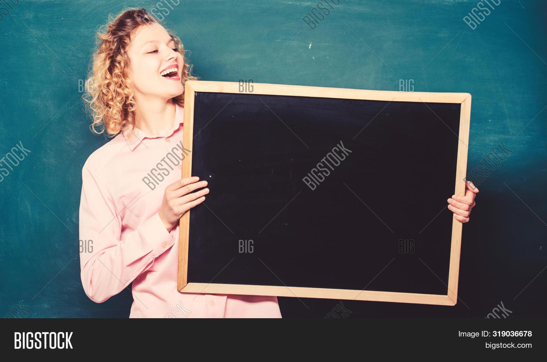 Customer Feedback. Place To Write Task. Happy Student Girl Hold Blank Board. Woman Teacher At Blackb